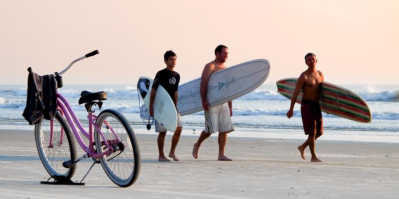 Three Surfers and a Bike