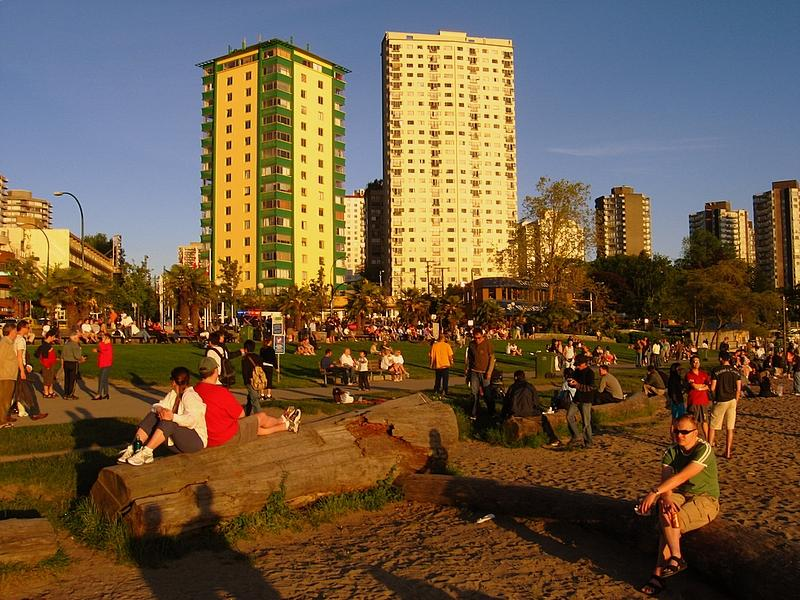 Taking the time to enjoy the setting sun along English Bay