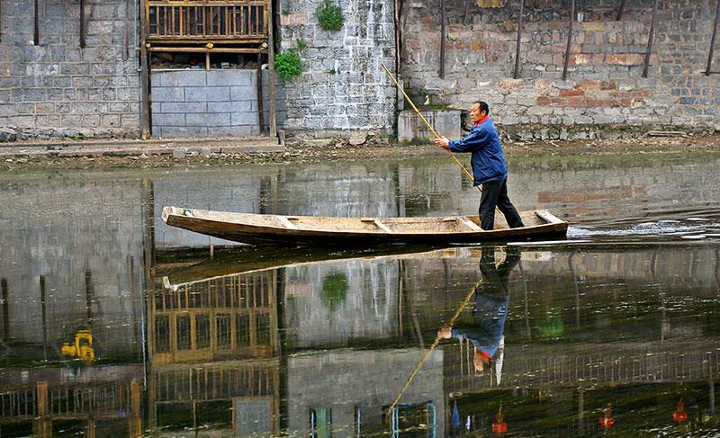 Pushing down the river. Fenghuang, Hunan Province, China