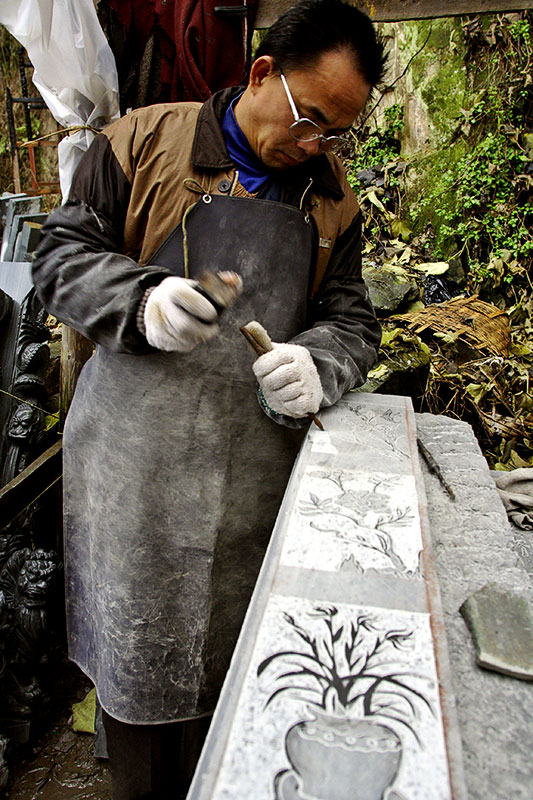 Carving a grave marker. Wuan Kou Town, Guizhou Province, China