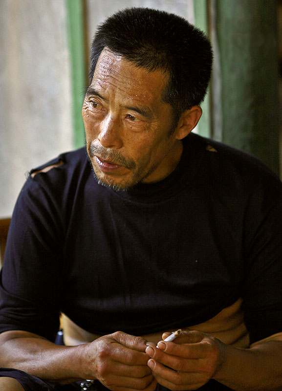 Talking about Buddhism. Wuling Mts., Hunan, China