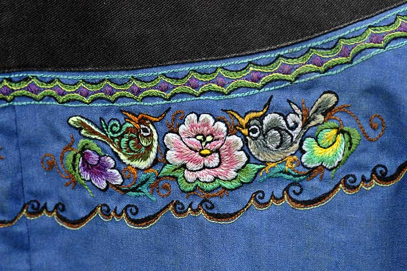 Hand embroidery representing her ancestors, which is normally seen on traditional Miao garmets.
