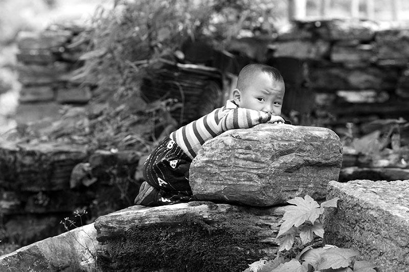 Kid on a rock.