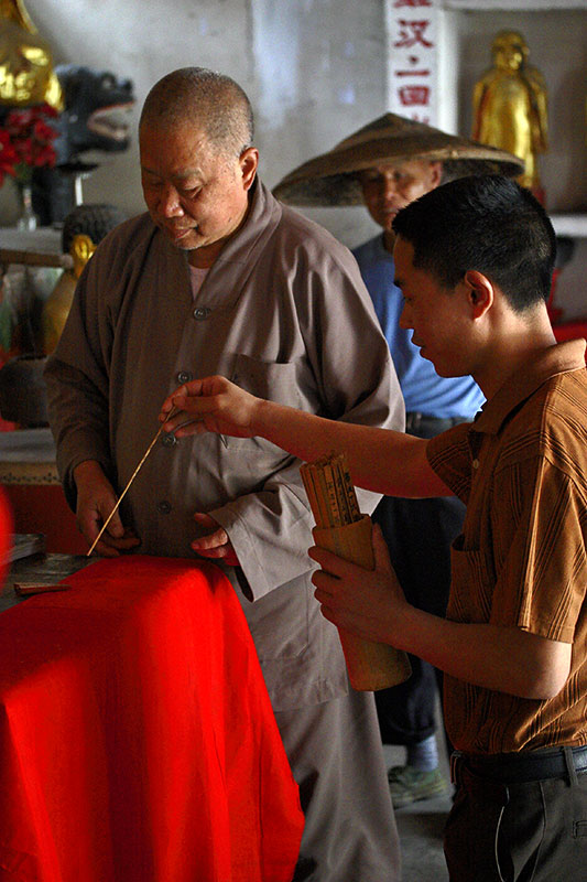 Buddhist monk preparing to tell fortune.
