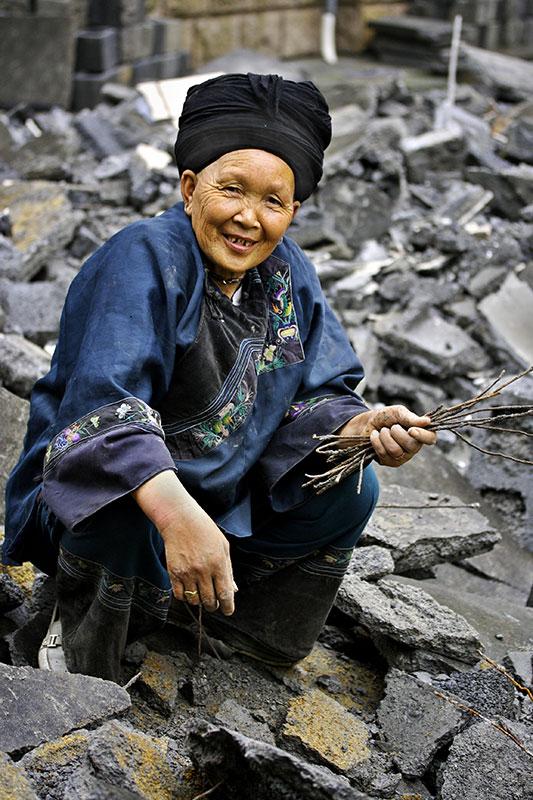 Miao elder collecting scrap metal.