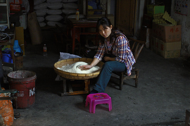 Pink stool. . . Cleaning rice.