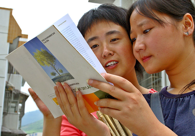 A university history major and journalist major reading about UNEP World Environment Day (WED).