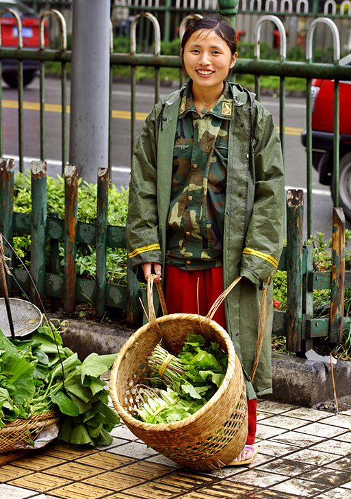 Sidewalk selling of produce and a friendly smile.