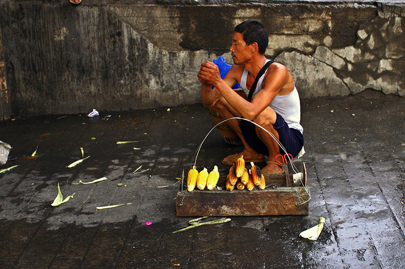Roasting corn. During the late Spring and Summer it is common to roast corn for sale.