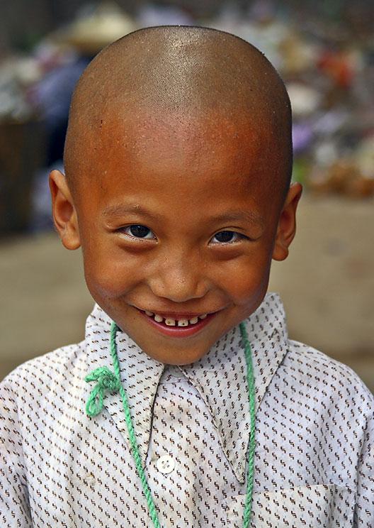 Boy at recycling center. Jishou City, China.