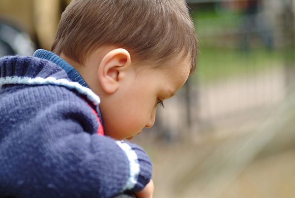 Little boy in his own world