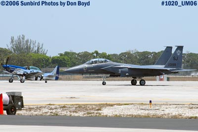 P-51 Crazy Horse and USAF McDonnell Douglas F-15E-44-MC Strike Eagle #AF87-0199 military air show stock photo #1020