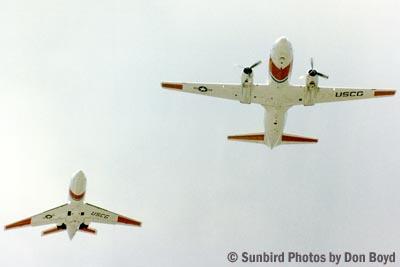 1982 - USCG HU-25 Falcon #CG-2109 and Convair HC-131A flying formation stock photo