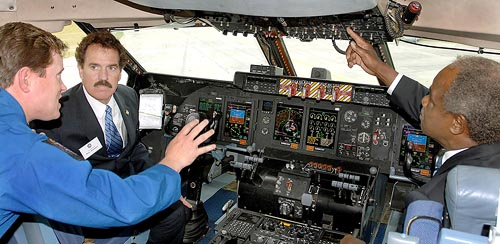 Attendees in the cockpit at the roll-out ceremony for the modernized C-5M