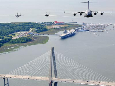 USAF F-15 Eagles and C-17 Globemaster III over the USS Yorktown and USCG Cutter at Charleston