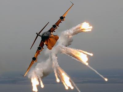 USAF C-17 Globemaster III releases flares over the Atlantic Ocean