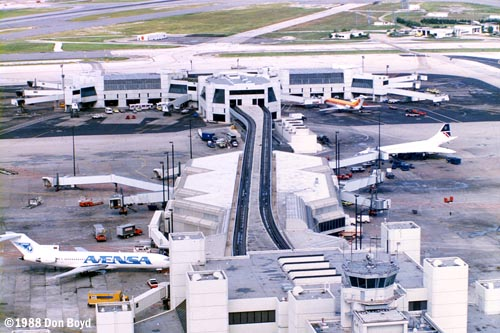 1988 - Concourse E and the E-Satellite at Miami International Airport aerial stock photo