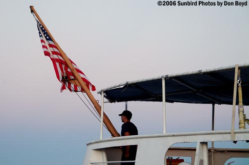2006 - Evening colors at the stern of the Coast Guard Cutter GENTIAN (WIX 290) stock photo #9331