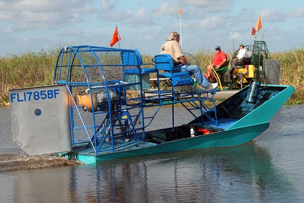 Bud Marquis, The Angel of the Everglades and his famous airboat leading the procession out to the crash site, photo #2882