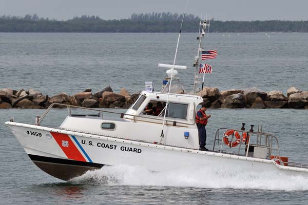 2008 - USCG 41-footer CG-41459 escorting the USCGC BERTHOLF out Government Cut stock photo #1958