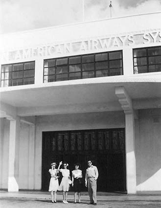 1942 - Miss Lutrelle Conger (waving) and co-workers outside Pan American Airways System hangar