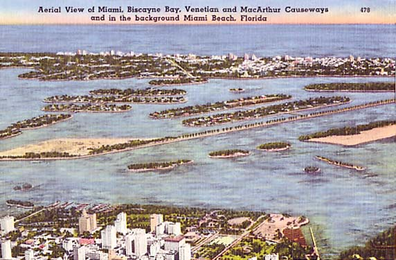 1940s - aerial view of downtown, MacArthur Causeway, Venetian Causeway, Biscayne Bay and Miami Beach
