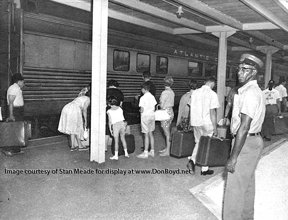 1960s - passengers and an Atlantic Coast Line Railroad train at the train station on NW 7th Avenue about 23rd Street
