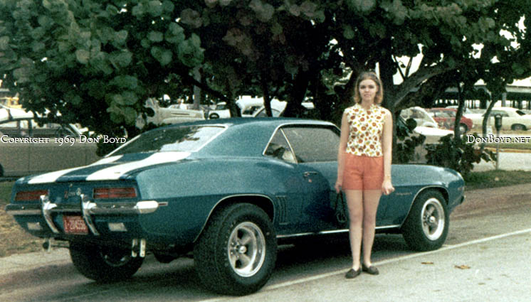 1969 - nice Camaro parked on Ocean Drive with the Miami Beach Kennel Club two-story parking garage in the right background