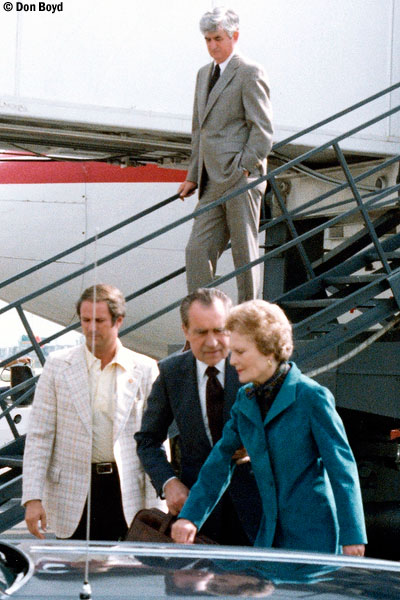 Late 80s - former President Richard M. Nixon and his wife Pat at Miami International Airport