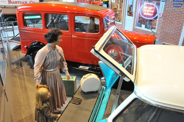 1935 Chevrolet Suburban Carryall in the background, and a 1957 Chevrolet 210 Station Wagon.