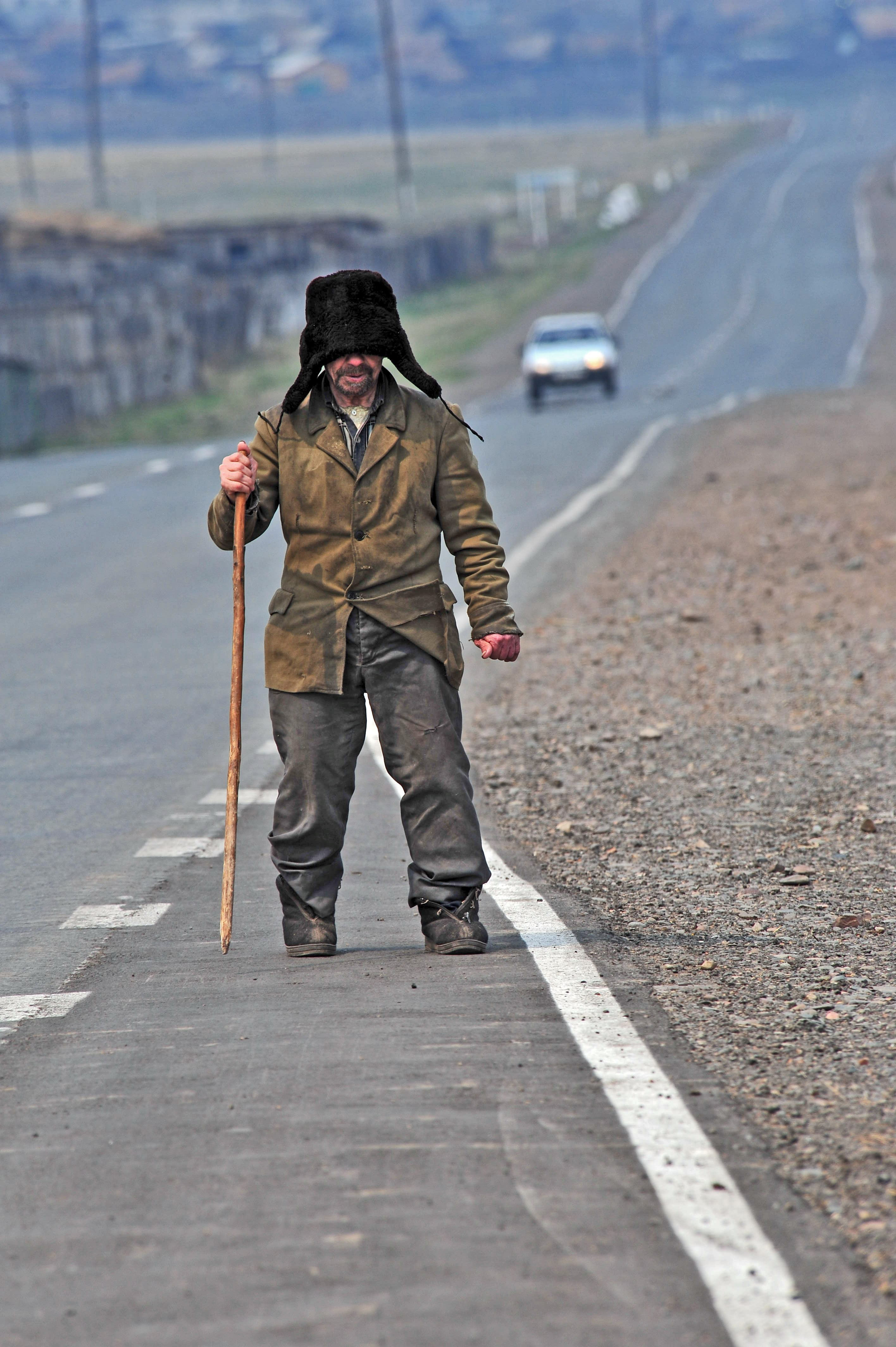 the blind person walking along a Siberian highway