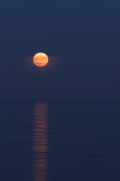 moon over blue water
