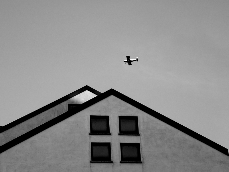 Urban landscape with airplane