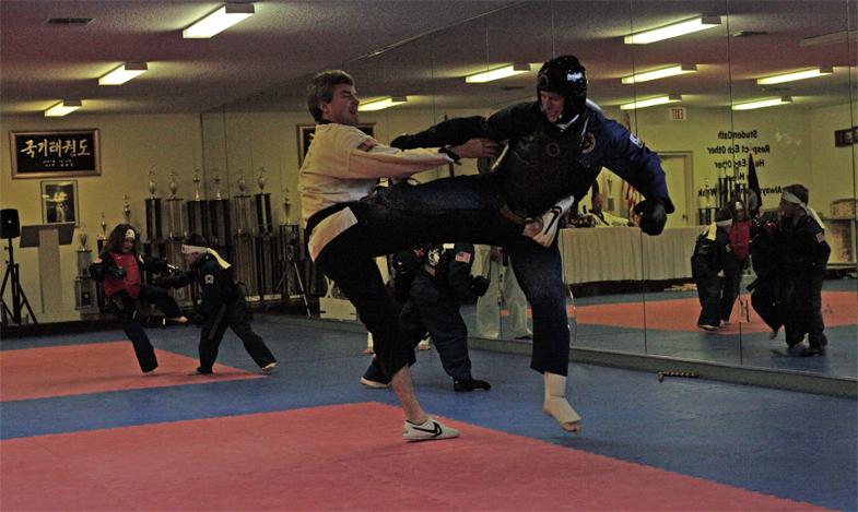 Feb 2006 Belt Test Rick Throwing Kick Sparring Black Belt.jpg