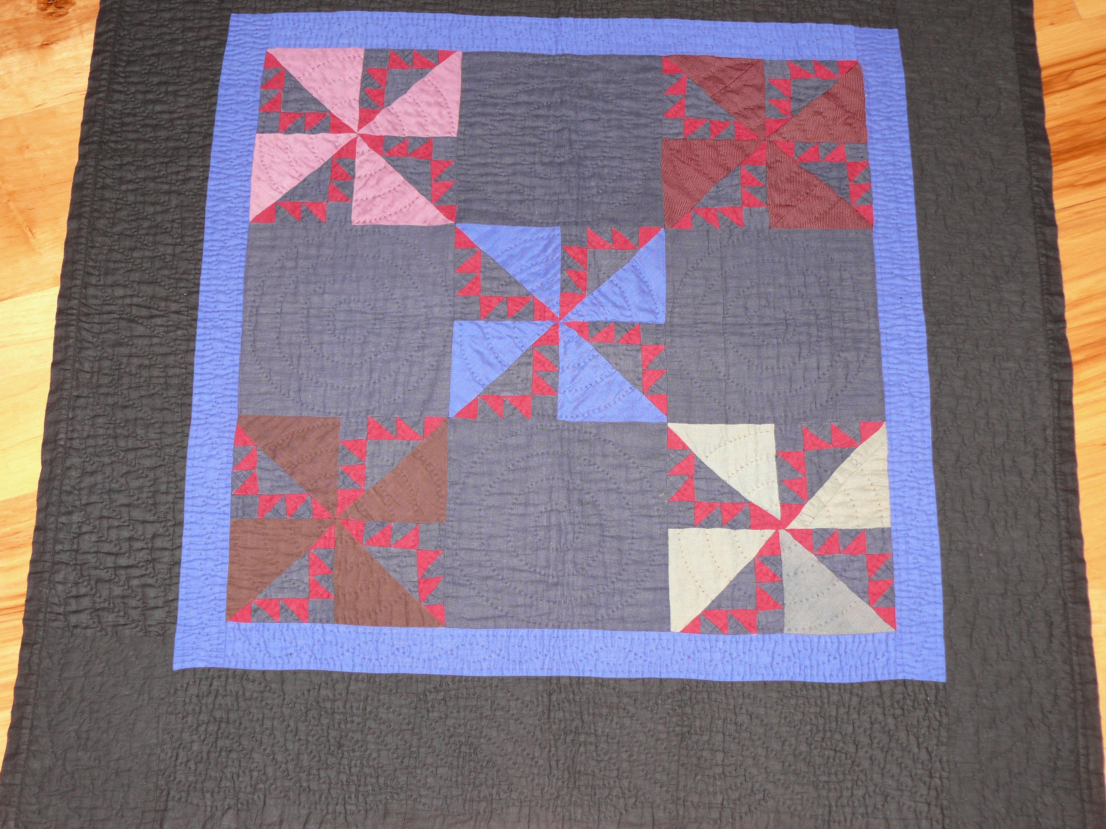 107: Pinwheel crib quilt, Holmes County, OH c. 1930 31x31