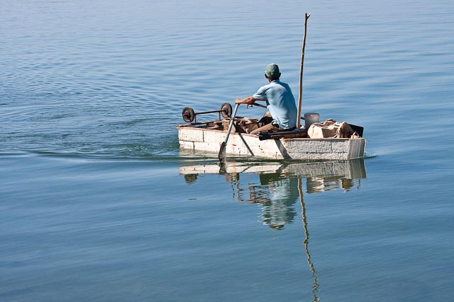 Fisherman in Styrofoam Boat