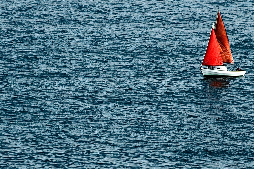 White boat, red sails, Cornwall