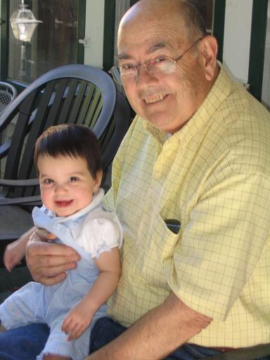 Evie relaxing on the porch with Grandpa Ted