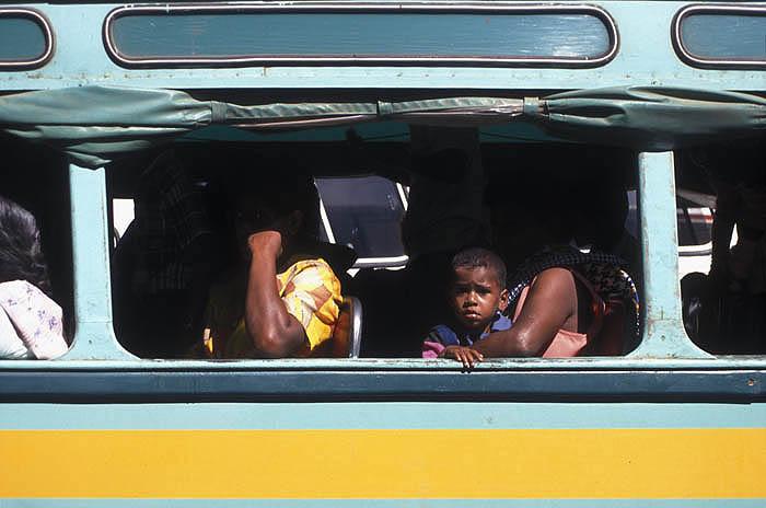 Passengers on a Fijian bus