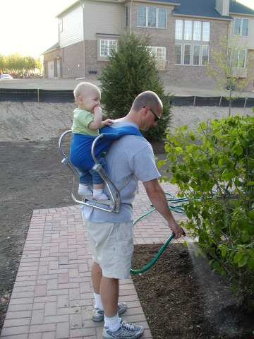 after landscaping, before sod.  J helps daddy.