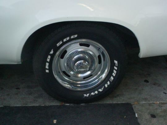 1975 El Camino wheel<br>1966 Chevy hubcap