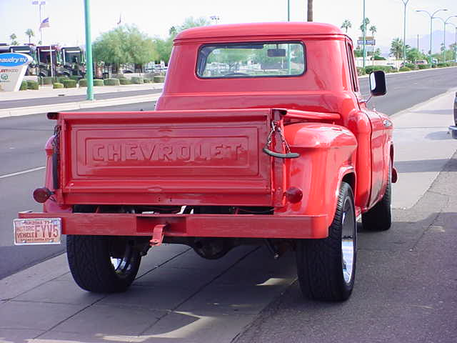 1957 Chevy pickup<br>custom red 3100<br>1/2 ton pickup truck
