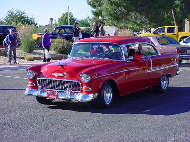 Guys red 55 Chevy