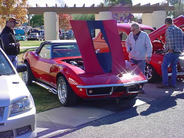 glistening red Corvette