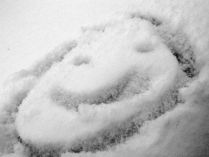 He draw the smiley face in the snow with his finger...