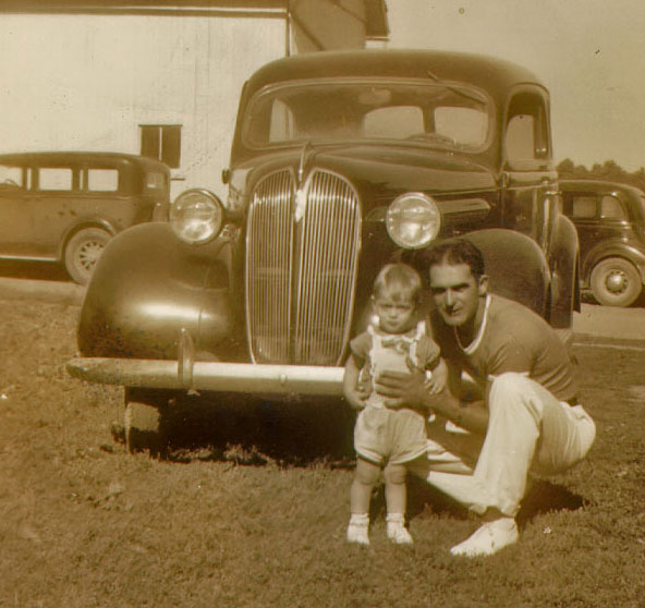 Just a baby ,taken with my father. Guess the year ?