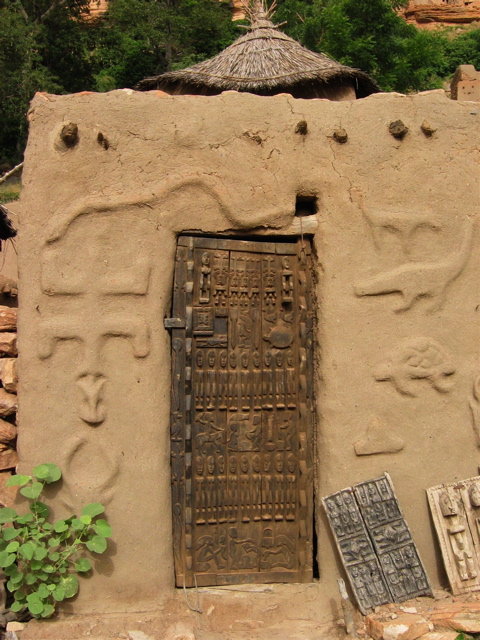 mud house with carvings, dogon country