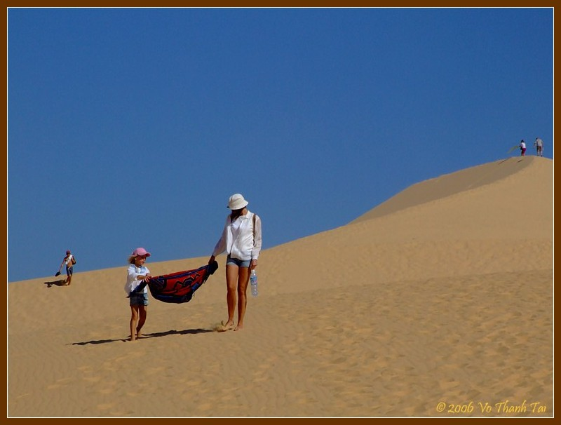 Family fun in sand dunes (white)