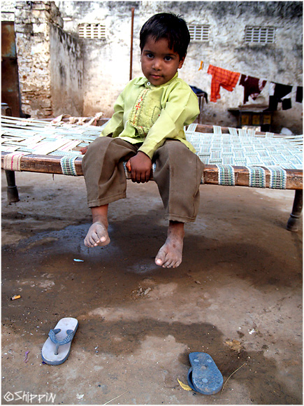 A boy outside his home, in a small village in Rajasthan.