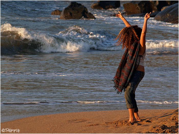 Girl dancing in a trance party at Half-Moon beach, Karnataka.